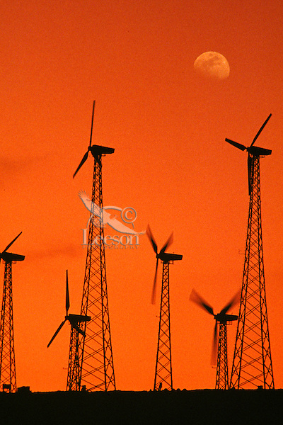 Wind turbines generating electricity at a windmill farm.  CA.  Sunset.