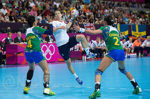 01 AUG 2012 - LONDON, GBR - Yvonne Leuthold (GBR) (centre) of Great Britain shoots during the women's London 2012 Olympic Games Preliminary round handball match against Brazil at The Copper Box in the Olympic Park, in Stratford, London, Great Britain .(PHOTO (C) 2012 NIGEL FARROW)