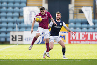 13th March 2021; Dens Park, Dundee, Scotland; Scottish Championship Football, Dundee FC versus Arbroath; Dale Hilson of Arbroath controls the ball as Christie Elliott of Dundee tries to close him down