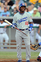 Chattanooga Lookouts right fielder Yasiel Puig #66 reacts to a called strike during the National Anthem  before a game against the Tennessee Smokies at Smokies Park on April 10, 2013 in Kodak, Tennessee. The Lookouts won 6-2. (Tony Farlow/Four Seam Images).