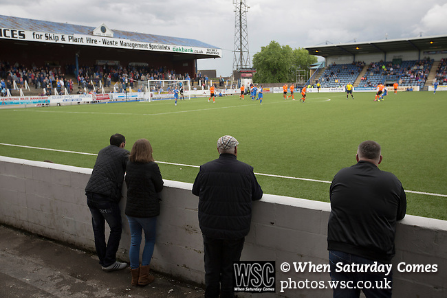 Queen of the South 2 Stranraer 0, 11/08/2015. Scottish Challenge Cup first round, Palmerston Park. Home supporters watching the action during the second-half at Palmerston Park, Dumfries, as Queen of the South (in blue) host Stranraer in a Scottish Challenge Cup first round match. The game was the opening match of the season in a competition open to sides below the Scottish Premiership. Queen of the South won the match 2-0, watched by a crowd of 1229 spectators. Photo by Colin McPherson.