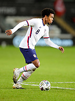 SWANSEA, WALES - NOVEMBER 12: Weston McKennie #8 of the United States dribbles with the ball during a game between Wales and USMNT at Liberty Stadium on November 12, 2020 in Swansea, Wales.