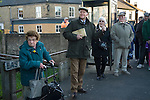 White Bread Meadow annual auction Bourne Lincolnshire UK.   Stephen Knipe auctioneer and land agent watches the children race and takes bids  for the auction as stipulated by Mathew Clay in his Will of 1742.