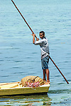 Locals on a boat transporting goods, on the coast of Viti Levu, Fiji