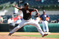 Miami Marlins pitcher Arquimedes Caminero (26) during a spring training game against the Houston Astros on March 21, 2014 at Osceola County Stadium in Kissimmee, Florida.  Miami defeated Houston 7-2.  (Mike Janes/Four Seam Images)
