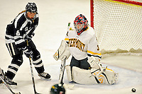 11 February 2011: University of New Hampshire Wildcat forward Arielle O'Neill, a Freshman from St. Catharines, Ontario, is stopped by goaltender Roxanne Douville during action against the University of Vermont Catamounts at Gutterson Fieldhouse in Burlington, Vermont. The Lady Catamounts defeated the visiting Lady Wildcats 4-2 in Hockey East play. Mandatory Credit: Ed Wolfstein Photo
