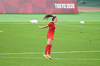 YOKOHAMA, JAPAN - AUGUST 6: Julia Grosso #7 of Canada celebrates making the winning PK during a game between Canada and Sweden at International Stadium Yokohama on August 6, 2021 in Yokohama, Japan.