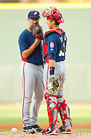 Potomac Nationals catcher Cole Leonida (13) has a chat on the mound with starting pitcher Matt Purke (38) during the Carolina League game against the Winston-Salem Dash at BB&T Ballpark on July 8, 2013 in Winston-Salem, North Carolina.  The Dash defeated the Nationals 12-9.  (Brian Westerholt/Four Seam Images)