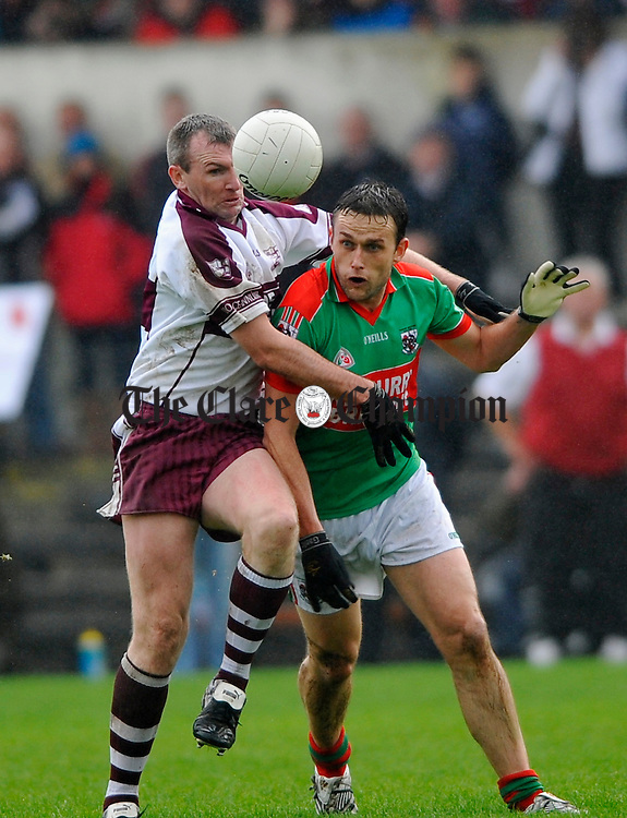 Kilmurry Ibrickane's Michael O Dwyer is tackled by Liscanor's Brian Considine during the Senior football county final in Ennis. Photograph by John Kelly.