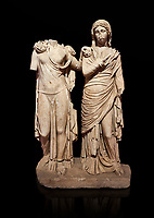 Roman statue of two women; Marble. Perge. 2nd century AD. Inv 3271. Antalya Archaeology Museum; Turkey. Against a black background.