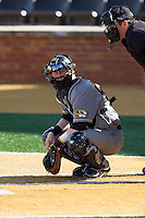 Missouri Tigers catcher Dylan Kelly (55) looks to the dugout for the sign during the game against the Radford Highlanders at Wake Forest Baseball Park on February 21, 2014 in Winston-Salem, North Carolina.  The Tigers defeated the Highlanders 15-3.  (Brian Westerholt/Four Seam Images)
