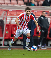 20th March 2021; Bet365 Stadium, Stoke, Staffordshire, England; English Football League Championship Football, Stoke City versus Derby County; Tommy Smith of Stoke City looks to pass the ball from the wing