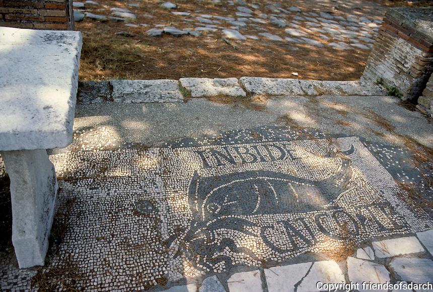 "Italy: Ostia--Mosaic floor of Fishmonger's Shop.  In Bide Calco Te seems to mean ""I tread on you."" Photo '83."