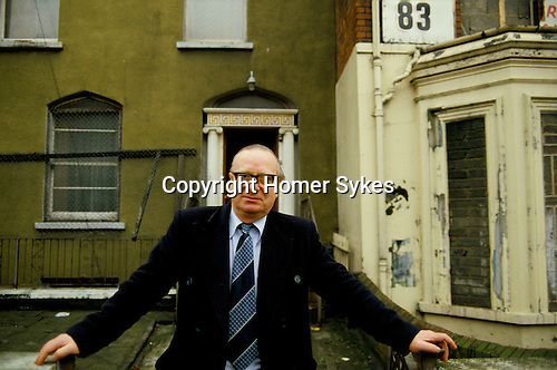 GERRY FITT OUTSIDE HIS FAMILY HOUSE AT 85 COUNTY ANTRIM BELFAST. IT LOOKS RUN DOWN BUT HAD BEEN ATTACKED ON VERY MANY OCCASIONS. Sir Gerry Fitt, founder of the SLDP and MP for West Belfast,