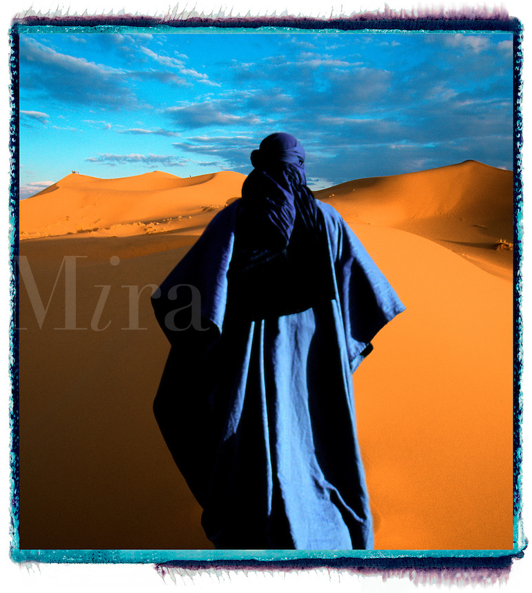 nomadic male figure wandering alone in the desert.