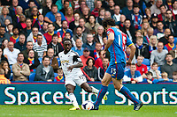 Sun 22 September 2013<br /> <br /> Pictured: Nathan Dyer of Swansea and Mile Jedinak of Crystal Palace<br /> <br /> Re: Barclays Premier League Crystal Palace FC  v Swansea City FC  at Selhurst Park, London