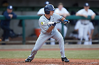 Trey Schramm (22) of the Xavier Musketeers squares to bunt against the Penn State Nittany Lions at Coleman Field at the USA Baseball National Training Center on February 25, 2017 in Cary, North Carolina. The Musketeers defeated the Nittany Lions 10-4 in game one of a double header. (Brian Westerholt/Four Seam Images)