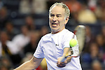 USA's John McEnroe returns the serve during the HSBC Tennis Cup series at First Niagara Center in Buffalo, NY on October 22, 2011