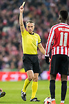 Referee David Fernandez Borbalan shows the yellow card to Raul Garcia (l) of Athletic Club as Andres Iniesta Lujan of FC Barcelona lies on the pitch during their Copa del Rey Round of 16 first leg match between Athletic Club and FC Barcelona at San Mames Stadium on 05 January 2017 in Bilbao, Spain. Photo by Victor Fraile / Power Sport Images