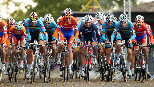 03 NOV 2012 - IPSWICH, GBR - Mike Teunissen (NED) (centre left in orange and blue ) of the Netherlands and Julian Alaphilippe (FRA) (centre right) of France find themselves surrounded by their Belgian rivals at the start of the Under 23 Men's European Cyclo-Cross Championships in Chantry Park, Ipswich, Suffolk, Great Britain (PHOTO (C) 2012 NIGEL FARROW)