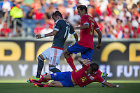 Orlando, Florida - Saturday, June 04, 2016: Paraguayan midfielder Edgar Benitez (11) avoids the slide tackle of Costa Rican defender Christian Gamboa (16) and keeps the ball away from Costa Rican midfielder Celso Borges (5) during a Group A Copa America Centenario match between Costa Rica and Paraguay at Camping World Stadium.