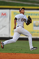 Greenville Astros shortstop Carlos Correa #12 tracks a ball during a game against the Burlington Royals at Pioneer Park on August 17, 2012 in Greenville, Tennessee. The Astros defeated the Royals 5-1. (Tony Farlow/Four Seam Images).