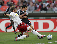 April 2, 2006: Washington, DC: DC United forward (11) is beaten to the ball by New York Red Bulls defender (23) Jeff Parke at RFK Stadium.  The game ended in a tie, 2-2.