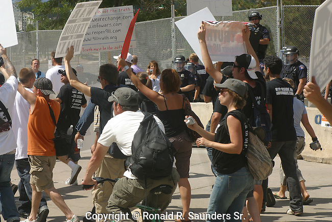 POLICE WATCH PROTESTORS OF WAR AT 2008 DEMOCRATIC CONVENTION