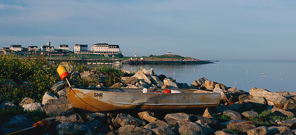 An old boat on the rocky shore of Smuttynose Island frames Star Island, Isles of Shoals, off Portsmouth, New Hampshire. Photograph by Peter E. Randall.