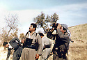 Iraq 1991.On march 7th, the first day of uprising, near Gela Zarda , Salah Mustafa with peshmergas,looking at the Iraqi fighter.Irak 1991.Le 7 mars, premier jour du soulevement,pres de Gela Zarda,  Salah Mustafa regardant dans le ciel les avions de combat irakiens