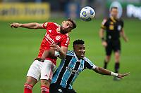 10th July 2021; Arena do Gremio, Porto Alegre, Brazil; Brazilian Serie A, Gremio versus Internacional; Bruno Cortez of Gremio loses the header to Yuri Alberto of Internacional