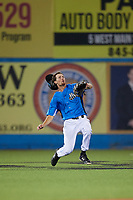 Hudson Valley Renegades center fielder Tanner Dodson (10) prepares to slide to try to catch a fly ball during a game against the Tri-City ValleyCats on August 24, 2018 at Dutchess Stadium in Wappingers Falls, New York.  Hudson Valley defeated Tri-City 4-0.  (Mike Janes/Four Seam Images)