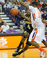 Nov 30, 2010; Clemson, SC, USA; Michigan Wolverines guard Darius Morris (4) drives the ball up the baseline against Clemson guard Cory Stanton (12) in the game against the Clemson Tigers at Littlejohn Coliseum. Mandatory Credit: Daniel Shirey/WM Photo -US PRESSWIRE