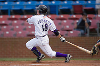 Logan Johnson #18 of the Winston-Salem Dash follows through on his swing versus the Potomac Nationals at Wake Forest Baseball Stadium May 8, 2009 in Winston-Salem, North Carolina. (Photo by Brian Westerholt / Four Seam Images)