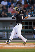 Jacob May (3) of the Charlotte Knights follows through on his swing against the Norfolk Tides at BB&T BallPark on April 20, 2016 in Charlotte, North Carolina.  The Knights defeated the Tides 6-3.  (Brian Westerholt/Four Seam Images)