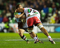 Ben Botica of Harlequins is high tackled by Pelu Taele of Biarritz Olympique during the Heineken Cup match between Harlequins and Biarritz Olympique Pays Basque at the Twickenham Stoop on Saturday 13th October 2012 (Photo by Rob Munro)