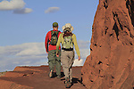 Man and woman on hiking trail leading to Delicate Arch in Arches National Park, Moab, Utah, USA. .  John offers private photo tours in Arches National Park and throughout Utah and Colorado. Year-round.