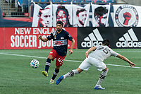 FOXBOROUGH, MA - SEPTEMBER 23: Lee Nguyen #42 of New England Revolution passes the ball as Emanuel Maciel #25 of Montreal Impact defends during a game between Montreal Impact and New England Revolution at Gillette Stadium on September 23, 2020 in Foxborough, Massachusetts.