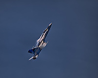 """A CF-18 Hornet goes for the vertical in """"The True North Strong and Free"""" colour scheme at the Canadian International Air Show."""