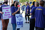 Caregivers at Bannister Center for Rehabilitation and Nursing in Providence hold an informational picket line calling on center owners to increase wages for front line workers who union officials say are paid significantly less than at nearby centers on Friday, October 8, 2021.(Photo/Joe Giblin)