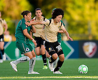 FC Gold Pride forward Eriko Arakawa (30) pushes away St Louis Athletica midfielder Lisa Stoia (7) during a WPS match at Korte Stadium, in St. Louis, MO, May 9 2009.  St. Louis Athletica won the match 1-0.