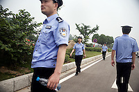 Police keep the road clear and watches the crowd of spectators during the Nanjing, China, leg of the 2008 Olympic Torch Relay.