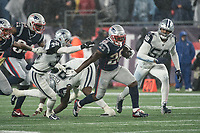 FOXBOROUGH, MA - NOVEMBER 24: New England Patriots Runningback Sony Michel #26 with Dallas Cowboys Safety Jeff Heath #38 and Dallas Cowboys Defensive End Robert Quinn #58 giving chase during a game between Dallas Cowboys and New England Patriots at Gillettes on November 24, 2019 in Foxborough, Massachusetts.