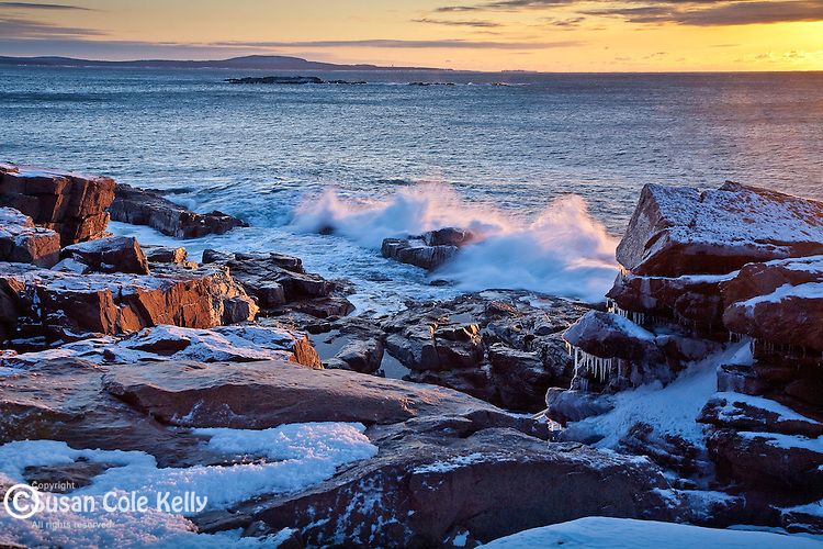 Snow blankets the rocky coast near Otter Cliffs, Acadia National Park, ME, USA