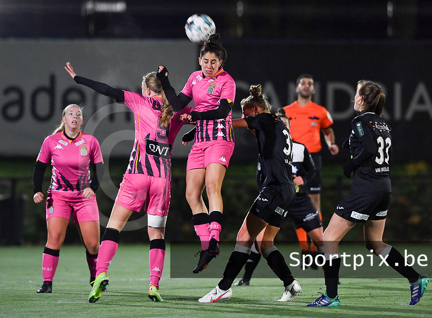 an airduel pictured with Ludmila Matavkova (9 Charleroi) , Ylenia Carabott (7 Charleroi) and Aalst's Margaux Van Ackere  during a female soccer game between Sporting Charleroi and Eendracht Aalst on the 8th  matchday of the 2020 - 2021 season of Belgian Scooore Womens Super League , friday 20 th of November 2020  in Marcinelle , Belgium . PHOTO SPORTPIX.BE | SPP | DAVID CATRY