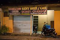 Bali, Indonesia.  Rental Car & Bike Store Front, Jimbaran.