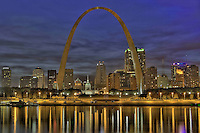 A high dynamic range (HDR), horizontal image of St. Louis, Missouri  at twilight with reflections in the Mississippi River.
