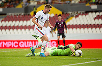 , MEXICO - : Djordje Mihailovic #8 of the United States makes a move towards the goal as Sebastian Jurado #12 of Mexico makes a save during a game between  and undefined at  on ,  in , Mexico.