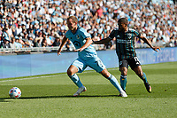 ST PAUL, MN - AUGUST 14: Chase Gasper #77 of Minnesota United FC and Samuel Grandsir #11 of the Los Angeles Galaxy battle for the ball during a game between Los Angeles Galaxy and Minnesota United FC at Allianz Field on August 14, 2021 in St Paul, Minnesota.