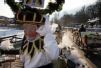 "The Schleichers wear masks and hats weighing up to 50 pounds as they parade in Scheischenlaufen, an ancient festival held every five years in the Tyrol (Tirol) region.  The custom is derived from cults and their rituals, going  as far back as the pre-Christian era.   The Telfs carnival has been held every 5 years since 1890.<br /> <br /> Scheischenlaufen.An ancient festival held every five years in the Tyrol (Tirol) region.  Telfs' Schleicherlaufen is one of the oldest traditions and one of  the largest carnivals in Tyrol. All in all, more than 500 people -  only men - in more than a dozen groups take part in this living tradition.<br /> The carnival procession consists of a seemingly mystic core, which is mainly represented by the ""Schleicher"" (Skulkers) and  the ""Wilden"" (Savages), and more groups where the emphasis  is on the funny, satirical element..Schleichers are picked up in a horse drawn carriage and taken to a meeting point. Wild Ones line up in the street to escort each parade group.  They used to scare the crowd to move them out of the way before there were police lines and tape..The highly decorated hats have been used for many years and are kept in the museum in Telfs until they are worn for the festival. <br /> They are very heavy--weighing up to 50 pounds, so it is quite an ordeal to balance one on the head for hours. They also wear masks and walk in the slow ceremonial procession in the parade giving a little shake to ring the bell on their butts.<br /> The origins of Telfs' Schleicherlaufen are unknown. The earliest documentation  dates back to 1612. However, there are well-founded speculations, that  this fascinating custom is derived from cults and their rituals, going  as far back as the pre-Christian era.  The Telfs carnival has been held every 5 years since 1890."